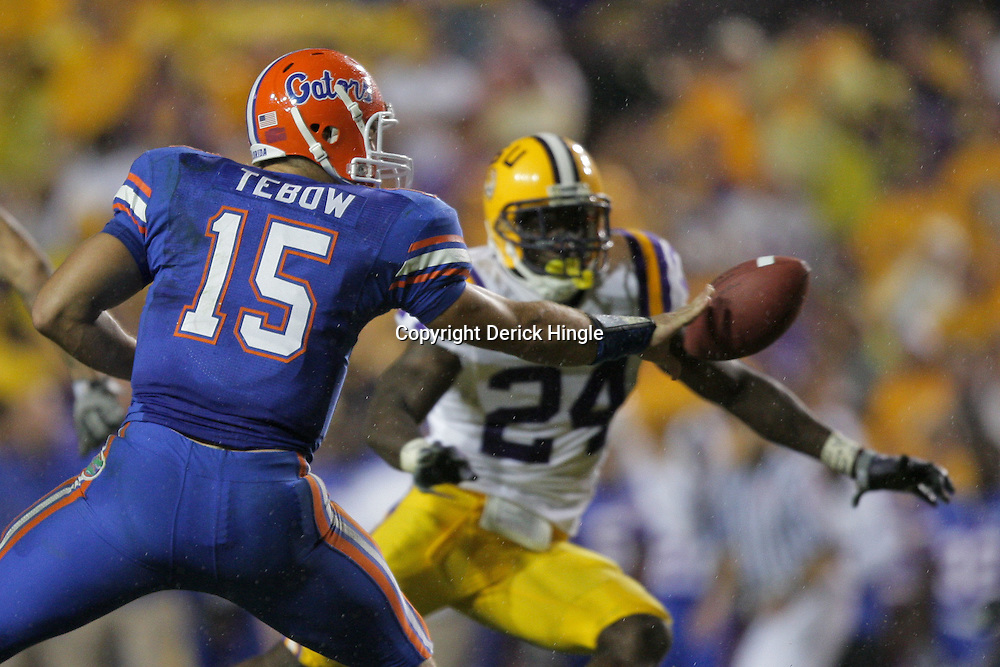 Oct 10, 2009; Baton Rouge, LA, USA;  Florida Gators quarterback Tim Tebow (15) pitches the ball as LSU Tigers linebacker Harry Coleman (24) pursues the play in the first half at Tiger Stadium. Florida defeated LSU 13-3. Mandatory Credit: Derick E. Hingle-US PRESSWIRE