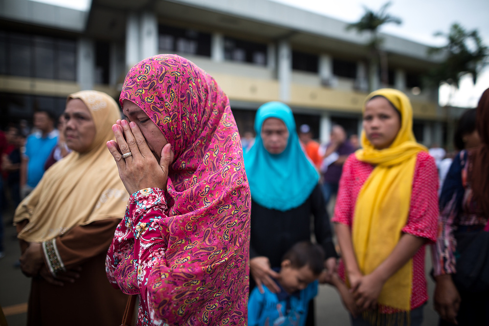 MARAWI, PHILIPPINES - JUNE 12: Local executives and citizens of Malawi City gathered for a symbolic flag raising ceremony to assert civilian authority and unity in celebration of  Independence Day on June 12, 2017. As fighting rages on for the third week, police hung Philippine flags  around war torn Marawi to  boost troop morale. (Photo: Richard Atrero de Guzman/NUR Photo)