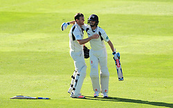 John Simpson of Middlesex celebrates victory with partner James Harris.  - Mandatory by-line: Alex Davidson/JMP - 13/07/2016 - CRICKET - Cooper Associates County Ground - Taunton, United Kingdom - Somerset v Middlesex - Day 4 - Specsavers County Championship Division One