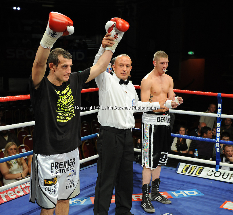 Derry Mathews (silver shorts) defeats George Watson for a Lightweight 8 x 3 min rounds contest at Olympia, Liverpool on the 11th June 2011. Frank Maloney Promotions.Photo credit: Leigh Dawney 2011