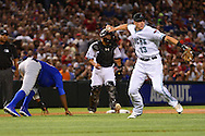 PHOENIX, ARIZONA - APRIL 08:  Nick Ahmed #13 of the Arizona Diamondbacks turns the double play on Anthony Rizzo of the Chicago Cubs (not pictured) in the fifth inning at Chase Field on April 8, 2016 in Phoenix, Arizona.  (Photo by Jennifer Stewart/Getty Images)