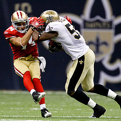 August 12, 2011; New Orleans, LA, USA; New Orleans Saints linebacker Nate Bussey (59) runs over San Francisco 49ers wide receiver Kevin Jurovich (14) while running back an interception during the second half of a preseason game at the Louisiana Superdome. The New Orleans Saints defeated the San Francisco 49ers Mandatory Credit: Derick E. Hingle