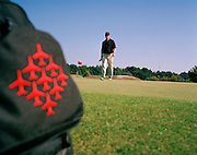 Squadron Leader Dave Thomas of the 'Red Arrows', Britain's Royal Air Force aerobatic team plays golf while off-duty in Jersey