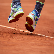 PARIS, FRANCE June 09. The tennis shoes of  Rafael Nadal of Spain as he serves against Dominic Thiem of Austria during the Men's Singles Final on Court Philippe-Chatrier at the 2019 French Open Tennis Tournament at Roland Garros on June 9th 2019 in Paris, France. (Photo by Tim Clayton/Corbis via Getty Images)