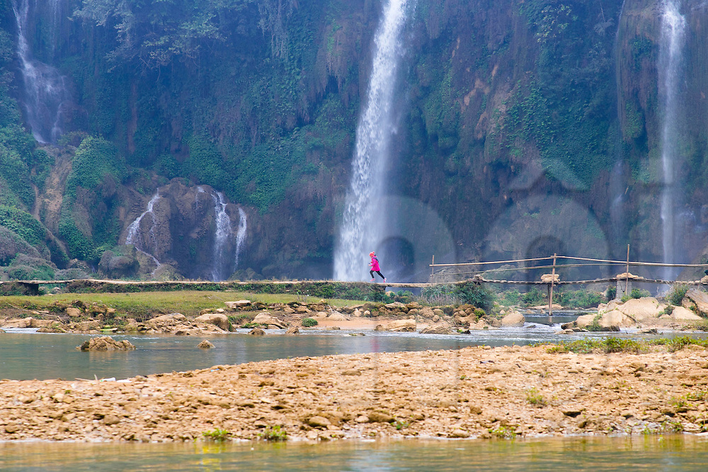 A girl runs on a path at Ban Gioc waterfall, Cao Bang Province, Vietnam, Southeast Asia