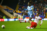 Fankaty Dabo of Coventry City (23) is tackled by Joe Mattock of Rotherham United (3) during the EFL Sky Bet League 1 match between Coventry City and Rotherham United at the Trillion Trophy Stadium, Birmingham, England on 25 February 2020.