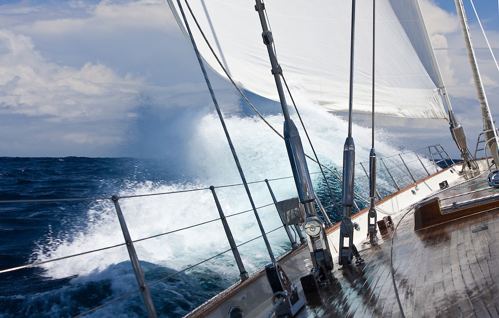 The sailing yacht Scheherazade as she steers herself across the Atlantic ocean using modern technology , beats into a wave
