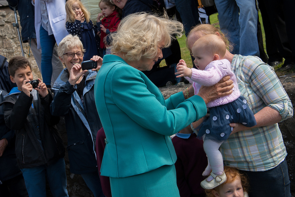 Pictures of THR the Prince of Wales and Duchess of Cornwall on their annual visit of Wales. They visited Llanarmon-yn-ial's Raven Inn. Photographer: Ioan Said