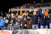 Cleveland Browns fans in the front row celebrate during the NFL week 10 regular season football game against the Cincinnati Bengals on Thursday, Nov. 6, 2014 in Cincinnati. The Browns won the game 24-3. ©Paul Anthony Spinelli
