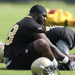 2008 May 21: New Orleans Saints first round draft pick, defensive tackle Sedrick Ellis #98 stretches during team organized activities at the Saints training facility in Metairie, LA. .