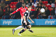 Salford City forward Mani Dieseruvwe challenge Grimsby Town midfielder Jordan Cook during the EFL Sky Bet League 2 match between Salford City and Grimsby Town FC at Moor Lane, Salford, United Kingdom on 17 September 2019.
