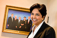 21 July, 2008. Purchase, NY. Indra Nooyi, 52, chairwoman and chief executive officer of PepsiCo, is here in her office at the PepsiCo World Headquarters. Next to her is a painting of the five CEOs of PepsiCo's history (L-R): Steven Reinemund (former CEO of PepsiCo), Don Kendall (co-founder of PepsiCo), Roger A. Enrico, Indra Nooyi and Wayne Collaway. She was named the CEO of PepsiCo on August 14 2006, becoming the fifth CEO in PepsiCo's 42-year history. <br /> ©2008 Gianni Cipriano for The Wall Street Journal<br /> cell. +1 646 465 2168 (USA)<br /> cell. +1 328 567 7923 (Italy)<br /> gianni@giannicipriano.com<br /> www.giannicipriano.com