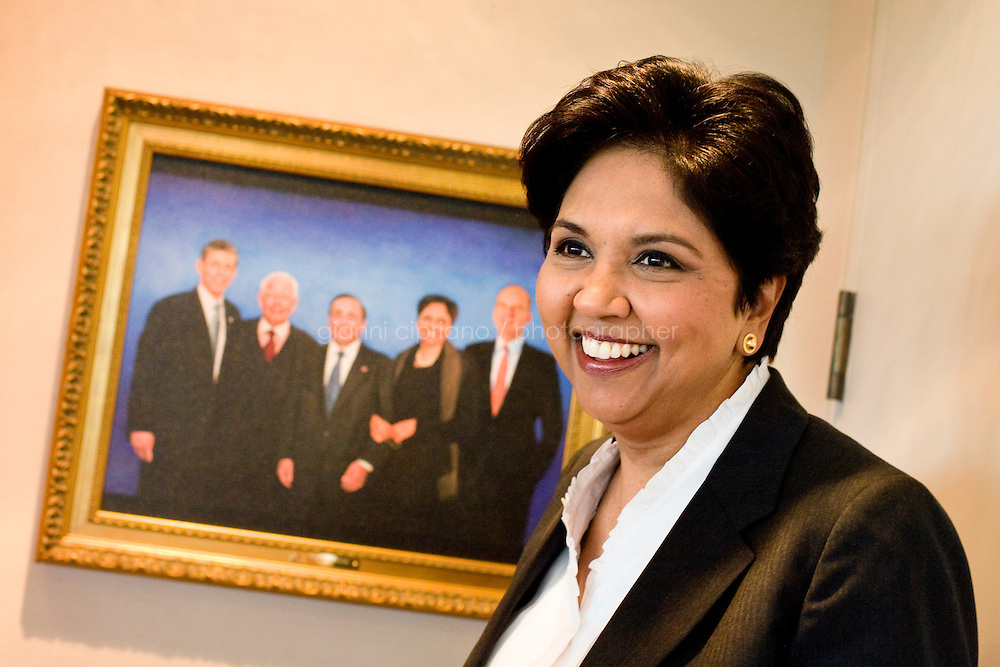21 July, 2008. Purchase, NY. Indra Nooyi, 52, chairwoman and chief executive officer of PepsiCo, is here in her office at the PepsiCo World Headquarters. Next to her is a painting of the five CEOs of PepsiCo's history (L-R): Steven Reinemund (former CEO of PepsiCo), Don Kendall (co-founder of PepsiCo), Roger A. Enrico, Indra Nooyi and Wayne Collaway. She was named the CEO of PepsiCo on August 14 2006, becoming the fifth CEO in PepsiCo's 42-year history. <br /> &copy;2008 Gianni Cipriano for The Wall Street Journal<br /> cell. +1 646 465 2168 (USA)<br /> cell. +1 328 567 7923 (Italy)<br /> gianni@giannicipriano.com<br /> www.giannicipriano.com