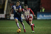Adam Buxton (Accrington Stanley) tackled by the Hartlepool defender during the Sky Bet League 2 match between Accrington Stanley and Hartlepool United at the Fraser Eagle Stadium, Accrington, England on 19 January 2016. Photo by Mark P Doherty.
