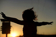 silhouette of a playful young girl