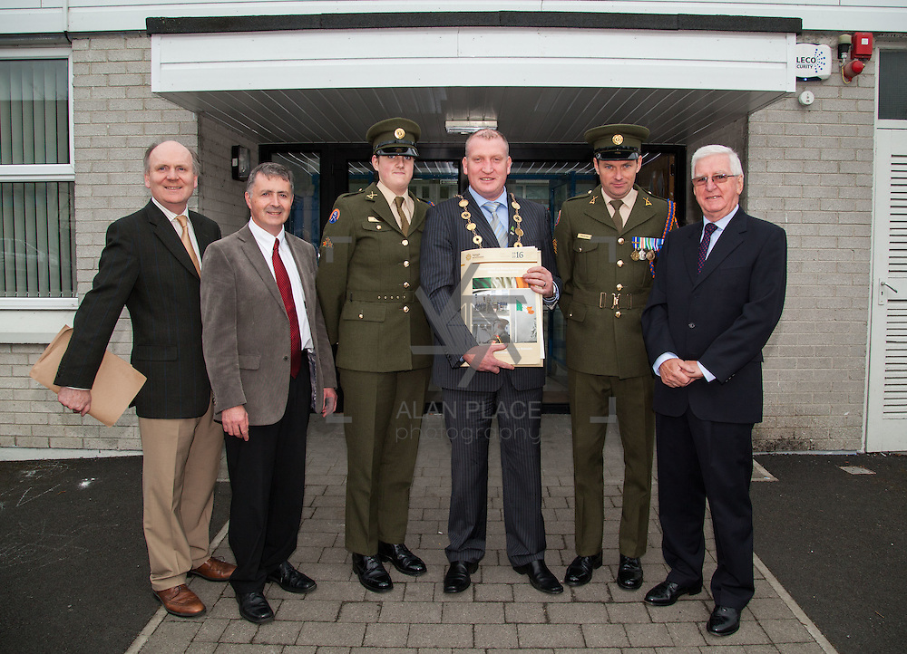 23/10/2015       <br /> Members of the Defence Forces were in Abbeyfeale today to present a handmade Tricolour and a copy of the Proclamation of the Irish Republic to students of the town's two primary schools.<br /> <br /> St Marys Boys National School and Scoil Mh&aacute;thair D&eacute; are among 3,000 schools nationally and 152 Limerick primary schools to receive the presentation as part of initiatives to mark the centenary of the 1916 Rising.&nbsp;<br /> <br /> Councillor Liam Galvin, Mayor of the City and County of Limerick joined pupils and teachers for today's presentation ceremony, which saw representatives of the Defences Forces raise the flag and read the Proclamation. <br /> <br /> Attending the ceremony at St. Marys Boys National School were, Danian Brady, Limerick City and County Co-Ordinator, Sean Woulfe, Principal, Private Ciara Quinn, Mayor of Limerick Cllr. Liam Galvin, Sergeant James Reddan and Con Daly, Chairman Of The Board St. Marys BNS. Picture: Alan Place.