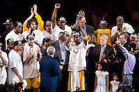 17 June 2010:  Guard Kobe Bryant of Los Angeles Lakers is presented the Bill Russell NBA Finals MVP Trophy and hold the trophy up by Bill Russell after the Lakers defeat the Boston Celtics 83-79 and win the NBA championship in Game 7 of the NBA Finals at the STAPLES Center in Los Angeles, CA.
