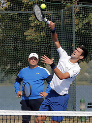 BELGRADE (SERBIA), Oct, 01, 2018  Serbia's tennis player Novak Djokovic serves the ball, while his coach Marin Vajda looks on, during open training session in Belgrade, Serbia on Oct, 01. 2018. (Credit Image: © Predrag Milosavljevic/Xinhua via ZUMA Wire)
