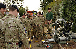 © Licensed to London News Pictures. 22/02/2014; Burrowbridge, Somerset. 39 Royal Engineers are installing a fuel pipeline along the river Parrett at Burrowbridge on the Somerset levels to supply a pump at Saltmoor.<br /> Photo credit: Simon Chapman/LNP