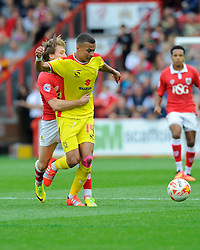 Bristol City's Luke Freeman battles for the ball with Milton Keynes Dons' Dele Alli  - Photo mandatory by-line: Joe Meredith/JMP - Mobile: 07966 386802 - 27/09/2014 - SPORT - Football - Bristol - Ashton Gate - Bristol City v MK Dons - Sky Bet League One