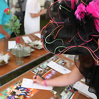 Kimberly Langley bids on an item at the 20th Annual Kentucky Derby Party silent auction to benefit Regional Rehab Center
