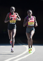 Edna and Florence Kiplagat of Kenya appear from the tunnel at the north end of Blackfriars Brdige during the Virgin Money London Marathon 2014 on Sunday 13 April 2014<br /> Photo: Paul Gregory/Virgin Money London Marathon<br /> media@london-marathon.co.uk