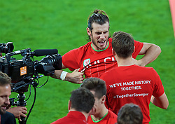 CARDIFF, WALES - Tuesday, October 13, 2015: Wales' Gareth Bale celebrates on the pitch with team-mate Chris Gunter after qualifying for the finals following a 2-0 victory over Andorra during the UEFA Euro 2016 qualifying Group B match at the Cardiff City Stadium. (Pic by Paul Currie/Propaganda)