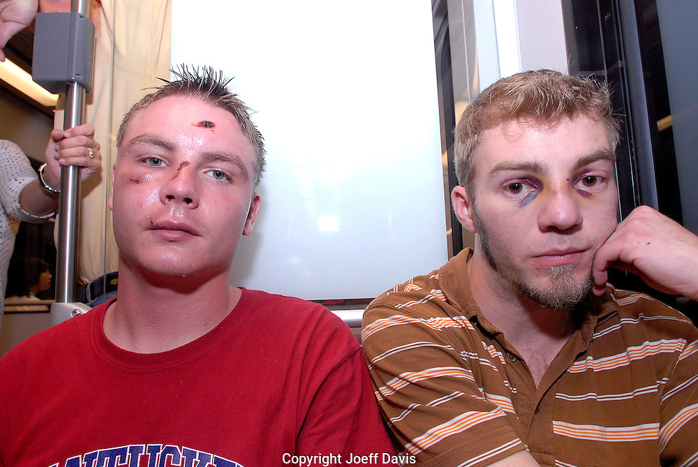 Eric (red shirt) and Clayton on the light rail after being beaten by police while protesting in downtown Denver, Colorado during the 2008 Democratic National Convention.