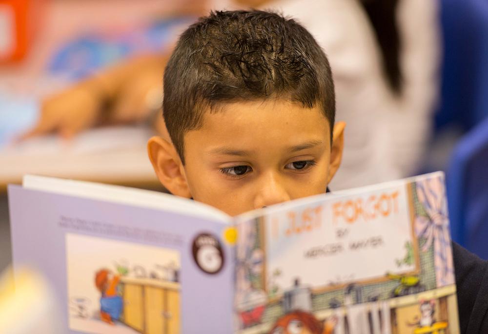 Students read at Garcia Elementary School, September 4, 2014.