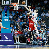 03 November 2015: Charlotte Hornets forward Cody Zeller (40) goes for the layup against Chicago Bulls forward Taj Gibson (22) during the Charlotte Hornets  130-105 victory over the Chicago Bulls, at the Time Warner Cable Arena, in Charlotte, North Carolina, USA.