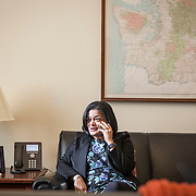 Representative Pramila Jayapal (D-WA, 7) spends a solitary moment in her Congressional office, speaking on the phone, before a series of meetings with constituent groups, on Tuesday, January 31, 2017.  John Boal photo/for The Stranger