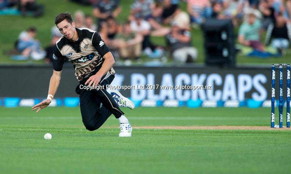 New Zealand's Mitchell Santner chases a ball.  New Zealand Blackcaps v Bangladesh, International Cricket, 1st T20, McLean Park, Napier, New Zealand. Tuesday, 03 January, 2017. Copyright photo: John Cowpland / www.photosport.nz