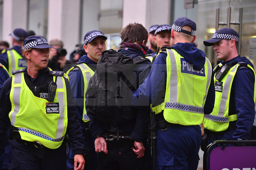 © Licensed to London News Pictures. 04/11/2015. London, UK.  A man being handcuffed as Demonstrators clash with police as Thousands of students take part in a demonstration in central London against tuition fees. The rally which starts outside the University of London Union, will feature a speech from Shadow Chancellor John McDonnell.  Photo credit: Ben Cawthra/LNP