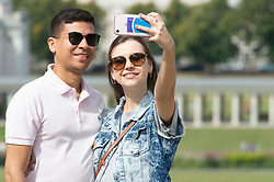 ©Licensed to London News Pictures 30/08/2019.<br /> Greenwich ,UK. Selfie in the sun. People out and about in Greenwich Park, Greenwich, London today enjoying the hot sunny weather. Photo credit: Grant Falvey/LNP