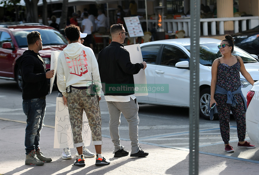 """EXCLUSIVE: Jersey Shore cast-mates Mike """"The Situation"""" Sorrentino, Vinny Guadagnino and Ronnie Ortiz-Magro walk down Ocean Drive carrying """"Do You Want to Marry/Date DJ Pauly D"""" signs while filming the reboot Jersey Shore: Family Vacation in Miami Beach, Florida. 31 Jan 2018 Pictured: Mike """"The Situation"""" Sorrentino, Vinny Guadagnino, Ronnie Ortiz-Magro. Photo credit: MEGA TheMegaAgency.com +1 888 505 6342"""