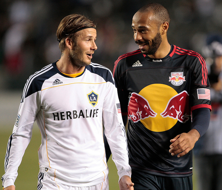 Los Angeles Galaxy's David Beckham, left, of England and New York Red Bulls' Thierry Henry of France talk as they walk off the field after their MLS soccer match, Saturday, May 7, 2011, in Carson, Calif. The game ended in a 1-1 tie. (AP Photo/Jason Redmond)