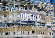 Buildings reflected by glass frontage of the Odeon cinema, Bath, Somerset, England