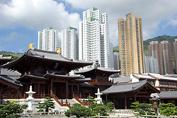 Contrast between modern high rise apartment buildings and traditional style Chi Lin Nunnery buildings in Hong Kong