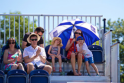 LIVERPOOL, ENGLAND - Sunday, June 18, 2017: Spectators keep cool under an umbrella during the Women's Final on Day Four of the Liverpool Hope University International Tennis Tournament 2017 at the Liverpool Cricket Club. (Pic by David Rawcliffe/Propaganda)