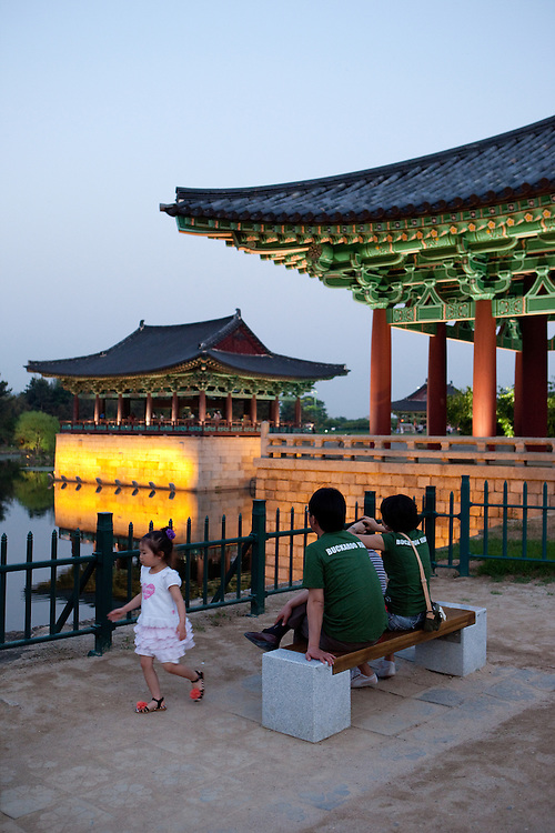 "Family during an evening at Anapji pond in the city of Gyeongju. Gyeongju was the capital of the ancient kingdom of Silla (57 BC - 935 AD) which ruled most of the Korean Peninsula between the 7th and 9th centuries. A vast number of archaeological sites and cultural properties from this period remain in the city. Gyeongju is often referred to as ""the museum without walls"". / Gyeongju, South Korea, Republic of Korea, KOR, 20th of May 2010."