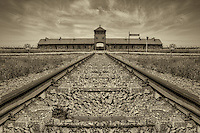 "The main entrance into Birkenau, also known as the Auschwitz II concentration camp. Beginning around the middle of May 1944, freight trains that were 40 to 50 cars long rolled through this gate, day and night, bringing thousands of Hungarian Jews to be gassed at the four Birkenau gas chambers. The prisoners called it the ""Gate of Death."""