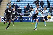 Bury Striker Leon Clarke closes in on Coventry City Defender Jack Stephens during the Sky Bet League 1 match between Coventry City and Bury at the Ricoh Arena, Coventry, England on 13 February 2016. Photo by Chris Wynne.