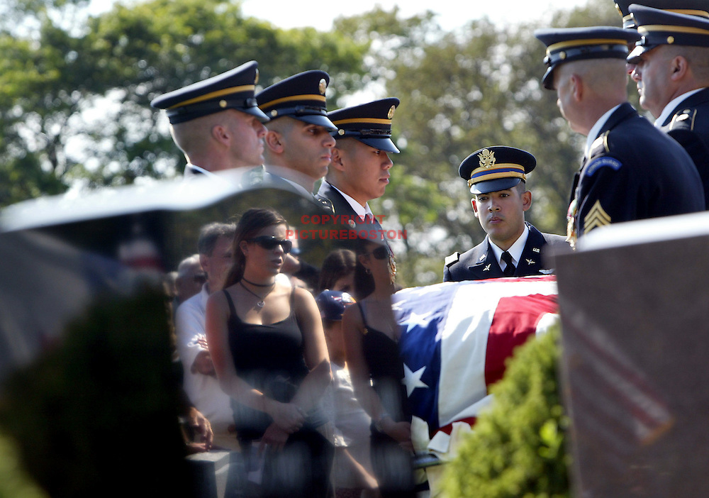 (09/28/06-Swampscott,MA) The funeral of Army Soldier Jared Raymond, age 20. Here, mourners are reflected at Swampscott cemetery.(092806raymondmg-Staff Photo:Mark Garfinkel.saved phto6/fri),