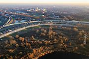 Nederland, Noord-Holland, Amsterdam, 11-12-2013; Knooppunt Coenplein, A8 (Coentunnelweg) en A10 (Ringweg Noord). Zonsondergang.<br /> Coenplein, junction near Zaandam  - North Amsterdam. Sunset.<br /> luchtfoto (toeslag op standaard tarieven);<br /> aerial photo (additional fee required);<br /> copyright foto/photo Siebe Swart.