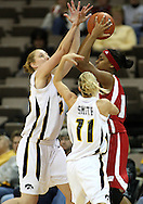 19 February 2009: Wisconsin guard Teah Gant (13) tries to pass the ball around Iowa forward/center JoAnn Hamlin (45) and Iowa guard Kristi Smith (11) during the first half of an NCAA women's college basketball game Thursday, February 19, 2009, at Carver-Hawkeye Arena in Iowa City, Iowa. Iowa defeated Wisconsin 72-65.