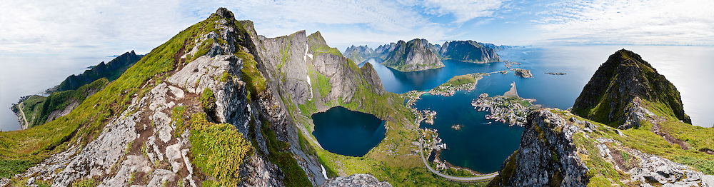 Above the Arctic Circle, ascend a slippery steep trail to Reinebringen for spectacular views of sharply glaciated peaks surrounding Reinefjord, on Moskenesøya (the Moskenes Island), Lofoten archipelago, Nordland county, Norway. Panorama stitched from 14 overlapping photos.
