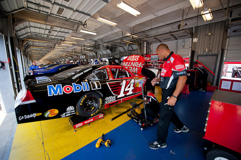 Sparta, KY - JUN 28, 2012: Tony Stewart's (14 ) team works in the garage to prepare for the Quaker State 400 at Kentucky Speedway in Sparta, KY.