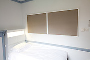 Above bed notice board, open