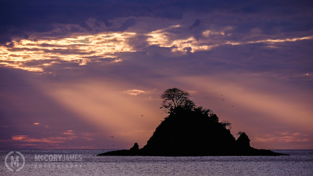 Looking at the sunset behind an island off the coast of Playa Danta in Costa Rica.