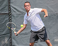 Luther's James Ayer eyes a return during a doubles match at the Iowa Conference Men's Tennis Championships at Veterans Memorial Tennis Center in Cedar Rapids on Saturday afternoon, May 5, 2012. Luther's Ayer and Mozena defeated Coe's Damisch and Woolf 8-3. (Stephen Mally/Freelance)